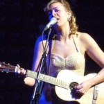 Jill Barber, playing a small guitar lefthanded.