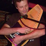 "Nick Basque, on autoharp in ""Bye, Bye, Bye."""