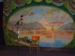 The mural at the back of the stage evokes old Brooklyn.