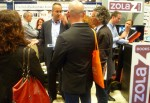 Zola Books' Joe Regal (c., in glasses) is speaking with Ira Silverberg (r.), literature director at the NEA