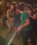 C-Mac dancing as Grant Lawrence (in green) joins her.