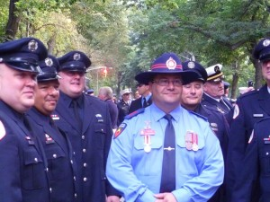 Many proud firefighters in hats.