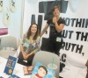 The booth of Nothing but the Truth was anchored by Karen Lynch's (seated) book Good Cop, Bad Daughter.